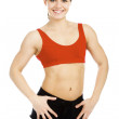 Stock Photo: Pretty fitness instructor posing against white background.