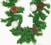 Spruce branches with Christmas balls on white background. — Stock Photo