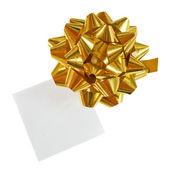Zlaté vánoční dárek luk na bílém pozadí — Stock fotografie