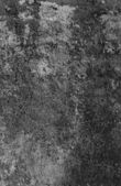Old ragged Painted black wall - texture background. — Stock Photo
