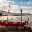 Chora Mykonos at bay against a background of blue sky and a small restauran — Stock Photo
