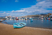 Fishing boats in the Bay of Chora Mykonos waiting out in the sea ... — Stock Photo
