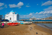 Church on Mykonos by the sea, surrounded by boats — Stock Photo