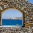 Stock Photo: Arched window overlooking the sea.