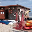 Small boating station on the Baltic beach. - Stock Photo