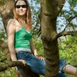 Girl on tree — Stock Photo