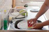 Washing dishes — Stock Photo