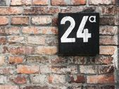 Wall with number — Stock Photo