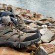 Shoes on stones - Stock Photo