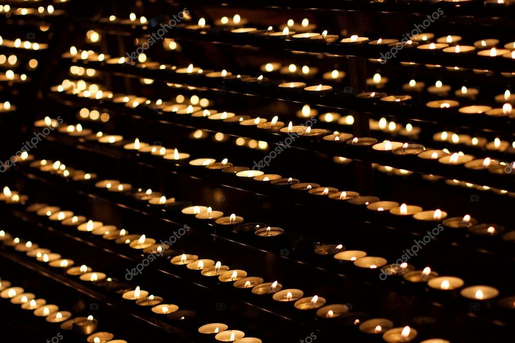 Rows of burning candles in a church — Stock Photo #4539427
