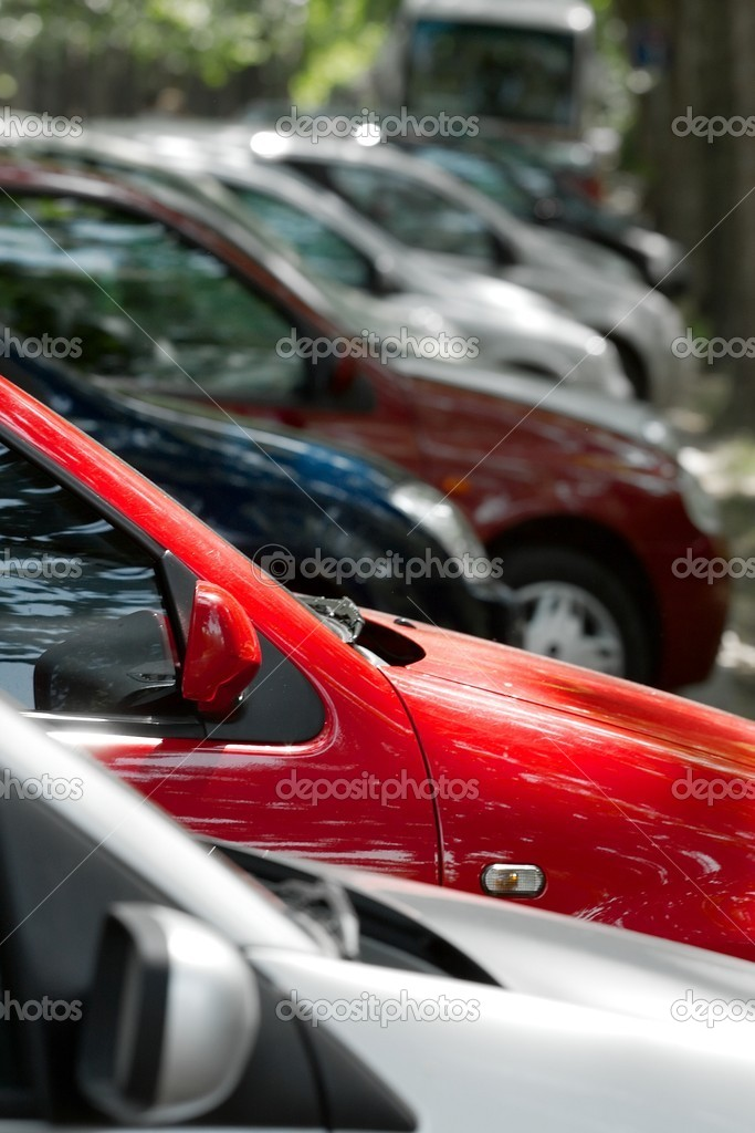 Row of parking cars, selective focus on the red one — Stock Photo #4636374