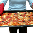 Woman holding pizza — Stock Photo #5208952