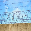 Stock Photo: Prison wall on blue sky background