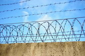 Prison wall on blue sky background — Stock Photo