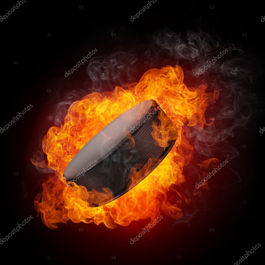 Hockey Puck in fire Isolated on Black Background — Stock Photo #4274361