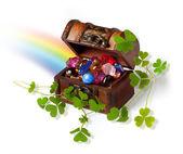 Treasure chest, shamrock branches and rainbow — Stock Photo