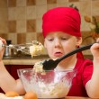 Boy helping at kitchen with baking a pie, little chef - Stock Photo