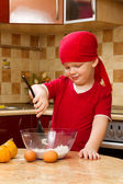 Boy helping at kitchen with baking a pie, little chef — Stock Photo