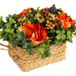 Decorative basket with artificial flowers — Stock Photo