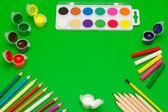 Art supplies on green — Stock Photo