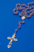 Rosary beads from glass with salver cross — Stock Photo