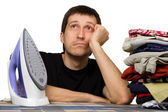Sad man, ironing board, wash clothing and iron — Stock Photo