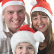 Real man with children in Santas hats — Stock Photo