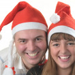 Father and daughter is in the caps of Santa claus — Stock Photo