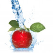 Red apple with leaves and water splash isolated on white — Stock Photo