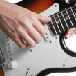 Playing on electric guitar — Stock Photo