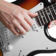 Playing on electric guitar - Stock Photo