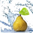 Yellow pear with leaf and water splash isolated on white — Stock Photo
