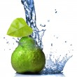 Green pear with leaf and water splash isolated on white — Stock Photo #4098276