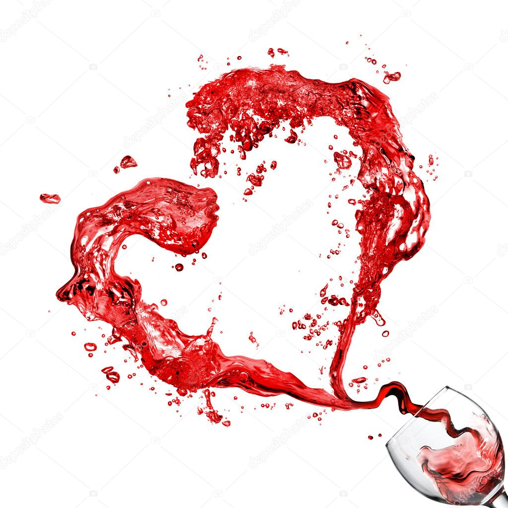 Heart from pouring red wine in glass goblet isolated on white  Photo #4850555