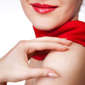 Attractive woman with red scarf isolated on white — Stock Photo