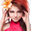 Portrait of beautiful woman with flower in hair on white - Stok fotoğraf