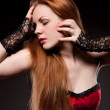Attractive sexy woman with red long hair on black — Stock Photo #5126331