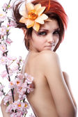 Portrait of beautiful woman with cherry flowers on white — Stock Photo
