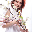 Portrait of beautiful woman with spring flowers on white — Stock Photo