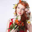 Portrait of beautiful woman with spring flowers — Stock Photo #5172004
