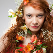 Stock Photo: Portrait of beautiful woman with spring flowers
