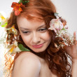 Portrait of beautiful naked woman with spring flowers - Photo