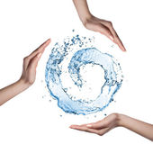 Water figure with human hand isolated on white — Stock Photo