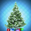 Xmas tree with gifts over dark blue - Foto Stock