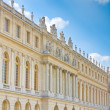 Stock Photo: Palace side with statues on top in Versailles