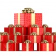 Pile of red gift boxes with presents — Stock Photo