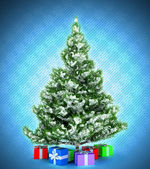 Xmas tree with gifts over dark blue — Stock Photo