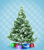 Xmas tree with presents over blue snowflakes — Stock Photo