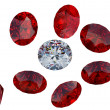 Large diamond among red rubies — Stock Photo #4067924
