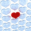 Red heart among frozen ones — Stock Photo